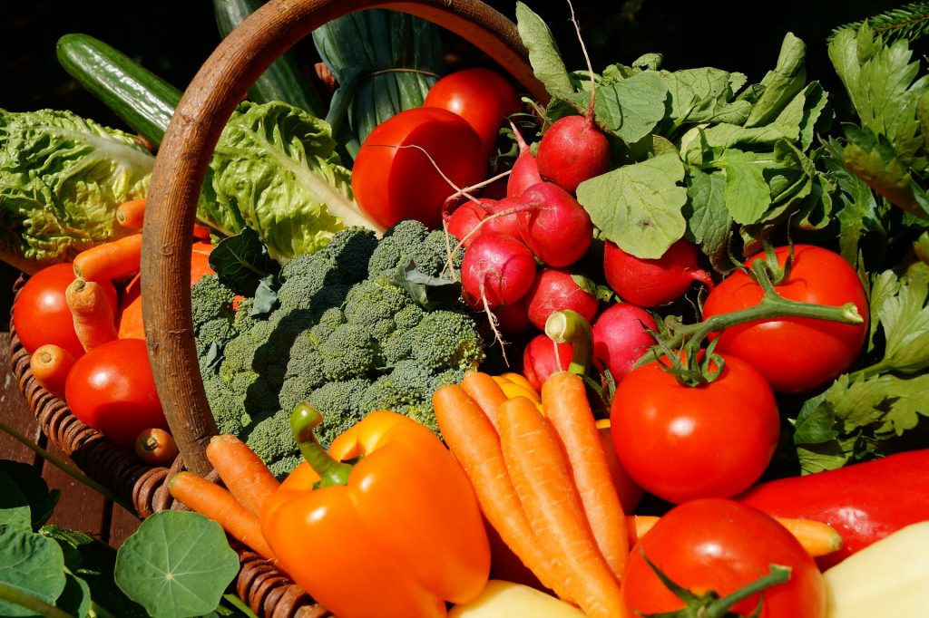 Image of a basket filled with fresh vegetables.